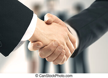 business handshake on office background