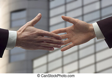 handshake - business handshake over blurry background