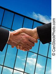Business handshake - a business hand shake outside the...