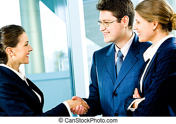 Business handshake - Business man and woman shaking hands...