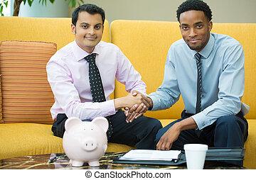 Business handshake - Closeup portrait, two young men in ties...