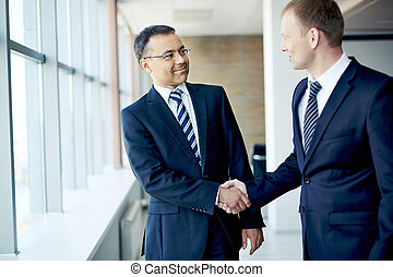 Business handshake - Portrait of elegant businessmen ...