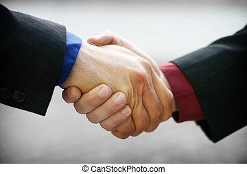 business handshake - Business men are shaking hands with red...