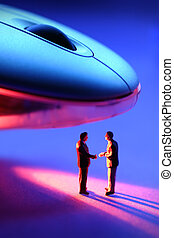 Business handshake under a infra red mouse