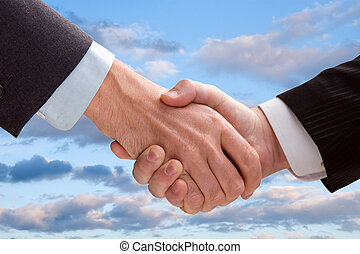 Business handshake - Two business men shaking hands on a...