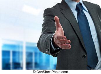 Business handshake - Modern businessman ready to handshake