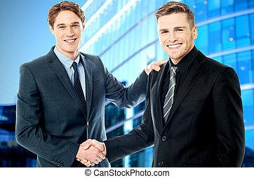 Business handshake, young entrepreneurs