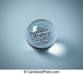 business icon in crystal ball on white computer keyboard