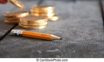 Business idea concept. Pencil with text and golden coins on vintage table. Copy space.