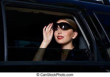 Business in Limo - Portrait of beautiful business woman...