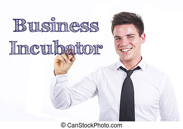 Business Incubator - Young smiling businessman writing on transparent surface