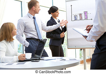 Image of business partners looking at whiteboard in office