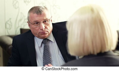 Business Interview - Mature manager having an interview with...