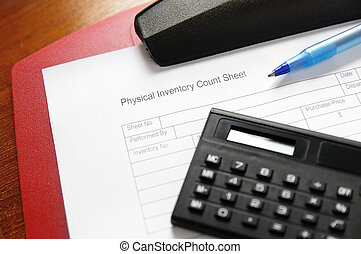 Business inventory sheet on a clipbpard with pen