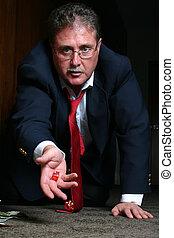 """Closeup of businessman """"shooting craps"""""""
