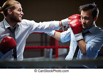 Business kick-boxers - Competitive businessman giving his...