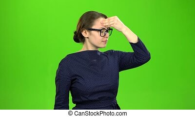 Business ladies suffer from headaches. Green screen
