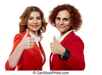 Business ladies thumbs up