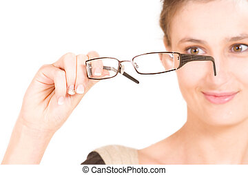 Business woman holding glasses. Shallow DOF - glasses in focus, eyes out of focus
