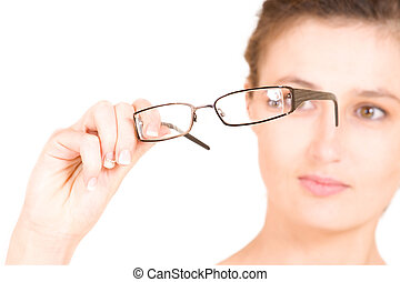 Business woman holding glasses. Shallow DOF - glasses in focus, eyes out of focus.