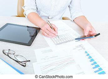 Business lady analyzing statistics