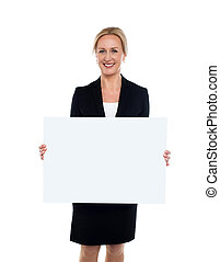 Business lady displaying blank white ad board