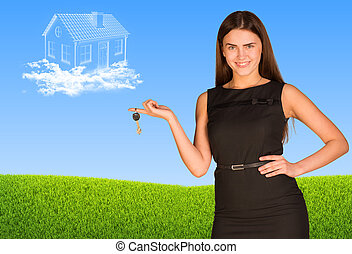 Business lady holding keys and clouds in form of house