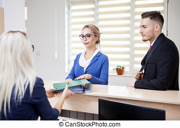 Business lady in the waiting are looking at secretary