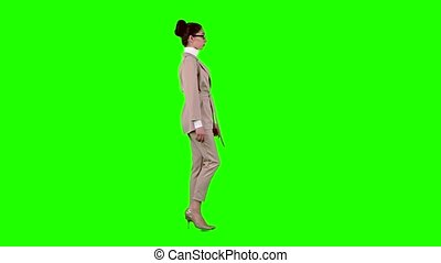 Business lady is going to a meeting. Green screen. Side view