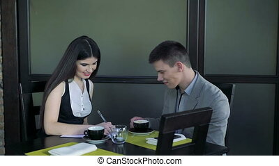 Business lady is meeting with customer in comfortable cafe