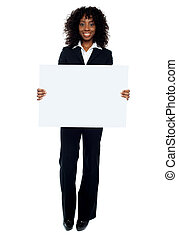 Business lady promoting big blank banner ad