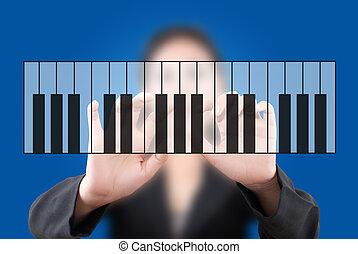 business lady push keyboard piano.