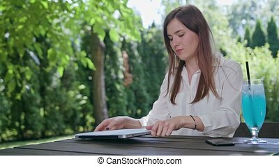 Business Lady Using a Laptop