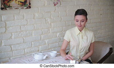 Business lady working at the cafe with smartphone
