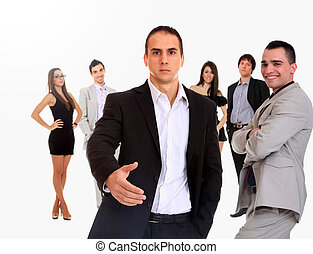 Business leader standing in front of his team