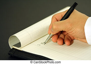 Business letter - A businessman writing a business letter