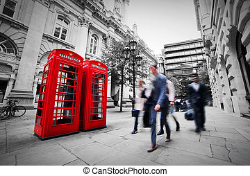 Business life concept in London, the UK. Red phone booth -...