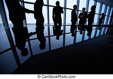 Business life - Group of business people standing against...