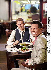 Two men having lunch in a restaurant