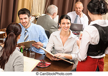 Business lunch waitress take order meal restaurant -...