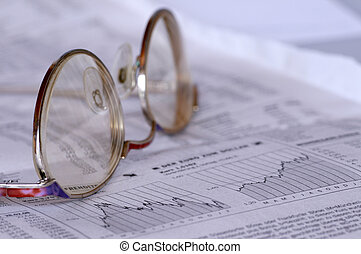 Stock price and eyeglasses on a newspaper