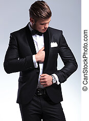business man adjusting suit