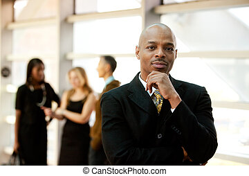 Business Man - An African American business man with...