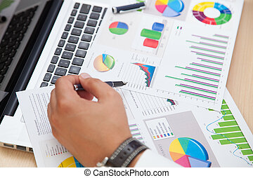 Business man analyzing financial