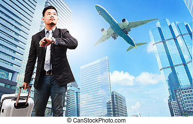 business man and belonging luggage watching to sky and hand watc