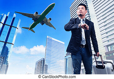 business man and big belonging luggage watching to sky and hand