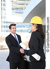 Business Man and Construction Woman - A handsome business...