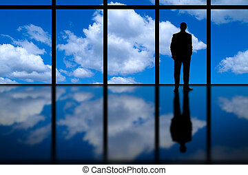 Business man and Highrise Window - A business man looking...