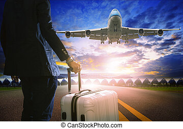 business man and luggage standing in airport and passenger jet p