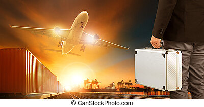business man and metal breifcase standing in front of cargo plane and logistic industry trains and shipping port